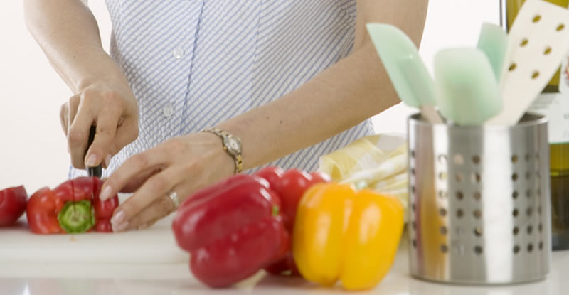 Woman Chopping Peppers